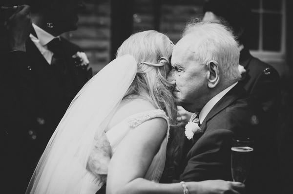 Bride hugging man