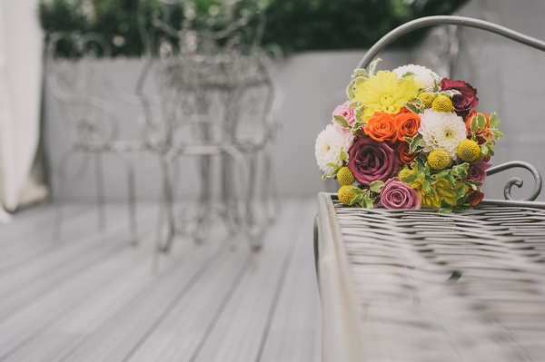 Bridal bouquet on end of bench