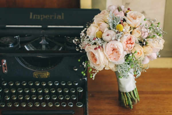 Old typewriter and wedding bouquet