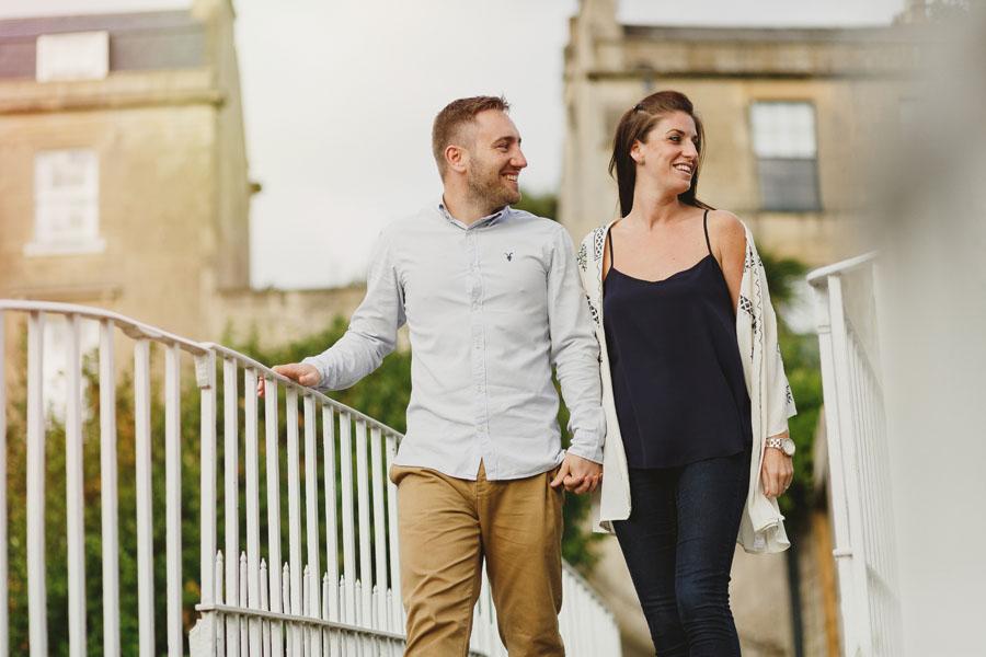 Couple walking across bridge