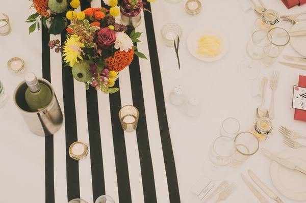 Flowers on black and white striped table cloth