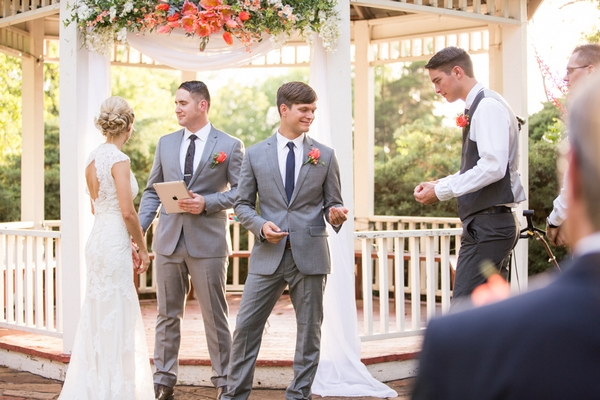 Best man giving groom rings