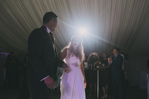 Bride and groom walking to dance floor