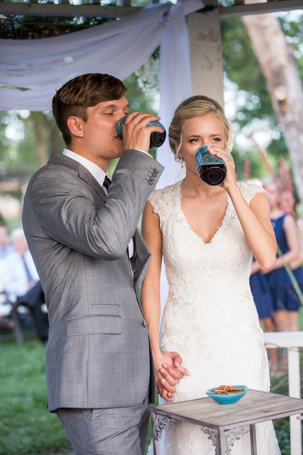 Bride and groom drinking from jars