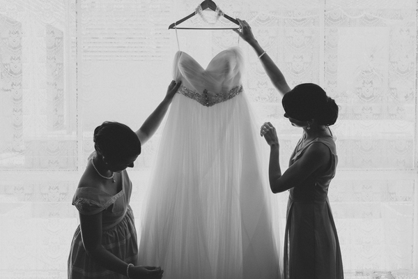 Holding up wedding dress