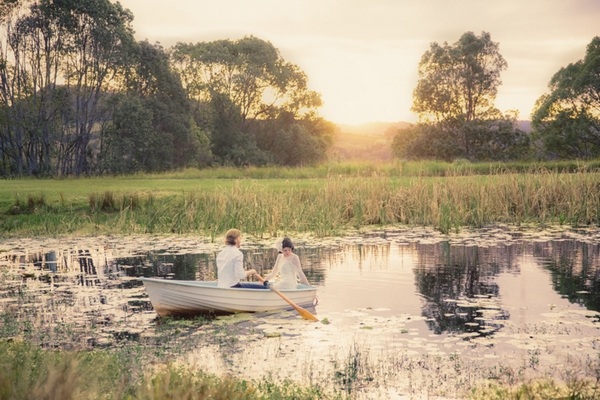 Brid and groom on rowboat