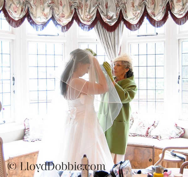 Bridal Preparation Photograph of Mother Helping Bride with Veil