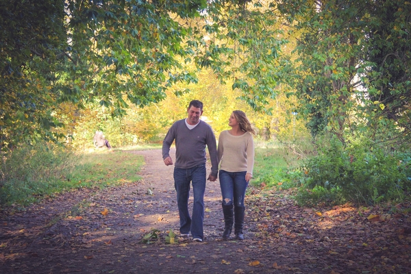 Couple walking in woods at Quakers Walk, Devizes
