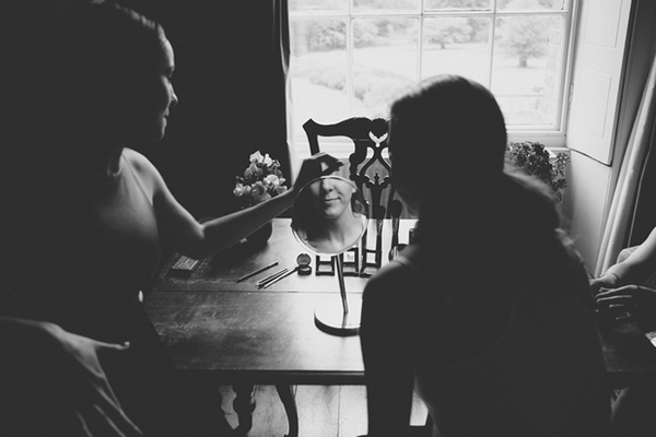 Reflection of bride in mirror