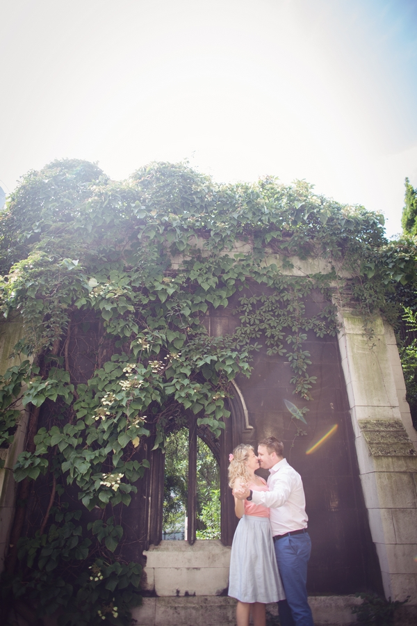 Couple in front of building covered in ivy