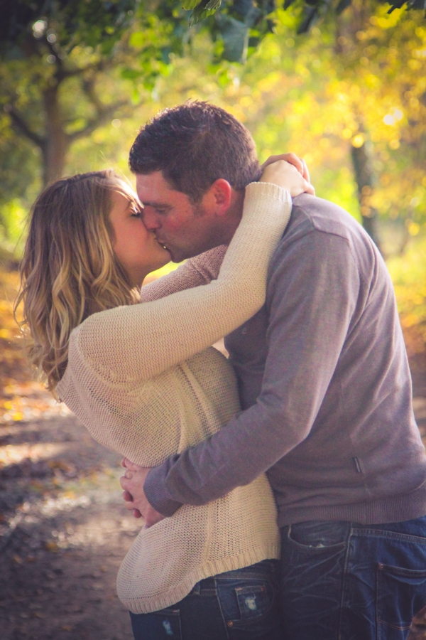 Couple kissing in woods at Quakers Walk, Devizes