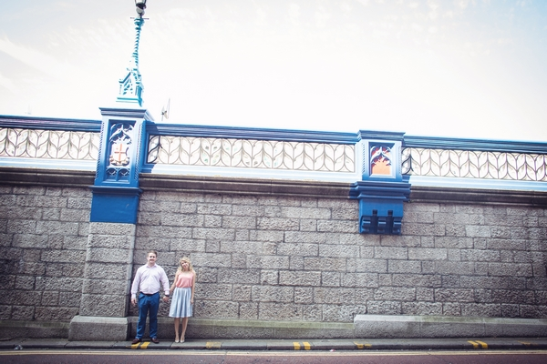 Couple standing in front of wall at Tower Bridge