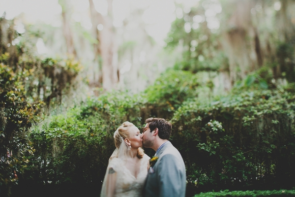 Bride and groom kissing at Magnolia Plantation and Gardens