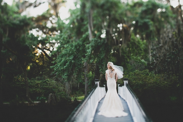 Bride walking over bridge