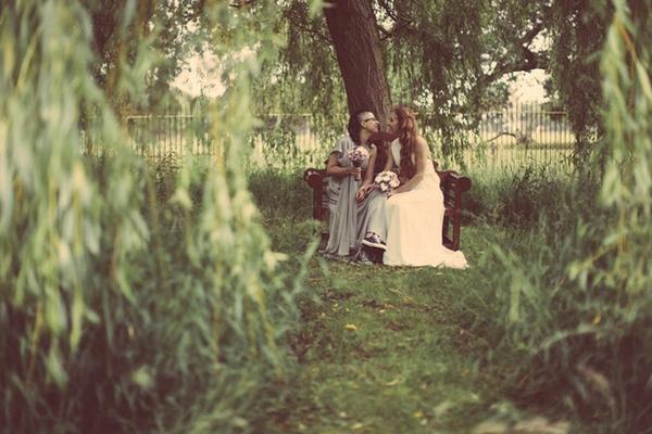 Brides sitting under tree
