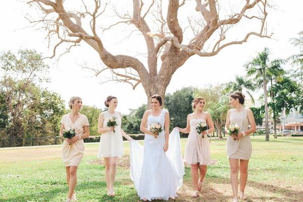 Bride and bridesmaids under a tree