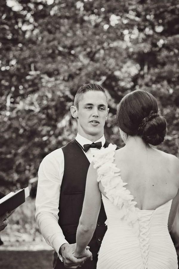 Groom in outdoor wedding ceremony