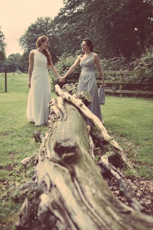 Brides by fallen tree