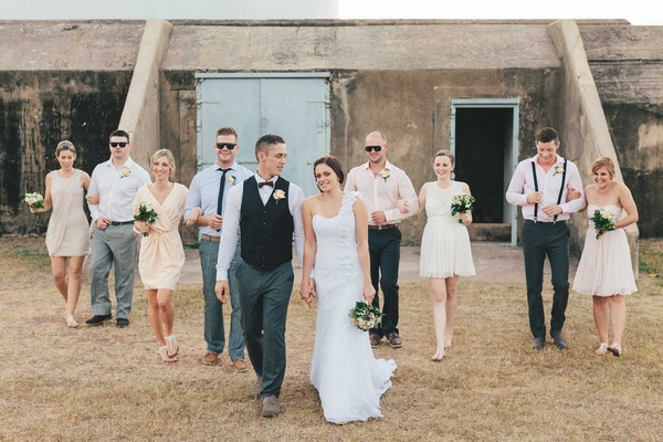 Bride And Groom Walking With Wedding Party