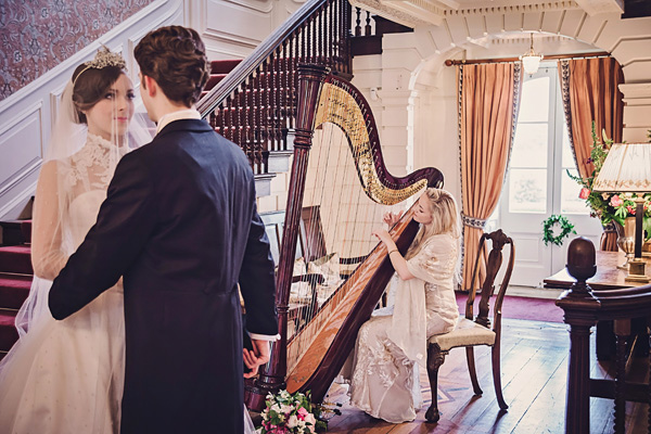 Bride and groom with harpist