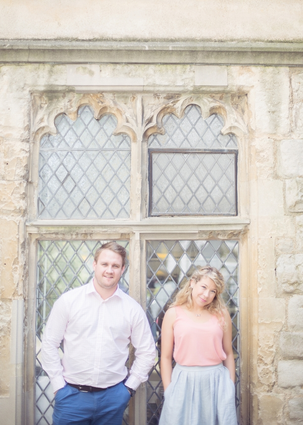 Couple standing in front of window