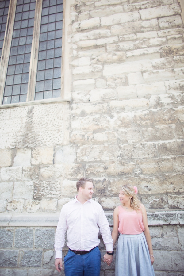 Couple standing next to wall
