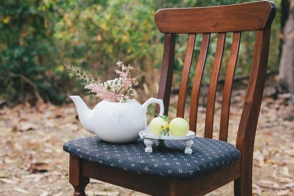 Teapot on chair