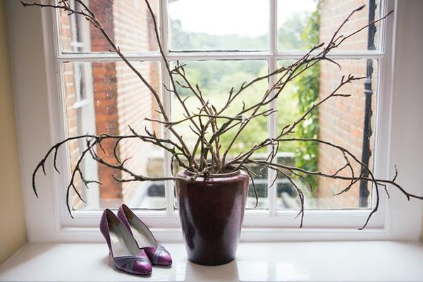 Bridal shoes next to plant pot