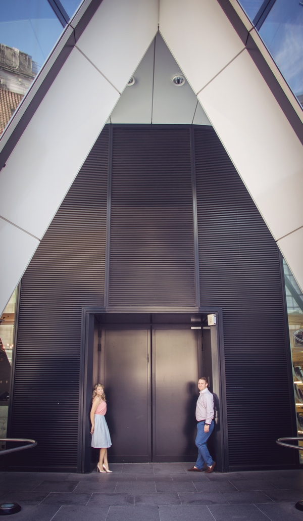Couple standing in front of lift at The Gherkin