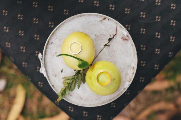 Wedding rings on fruit