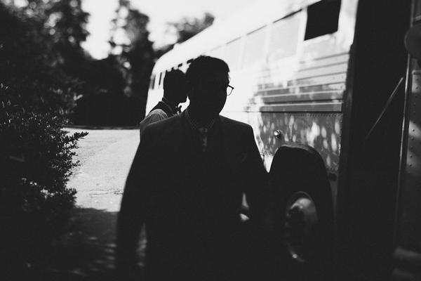 Man walking past bus