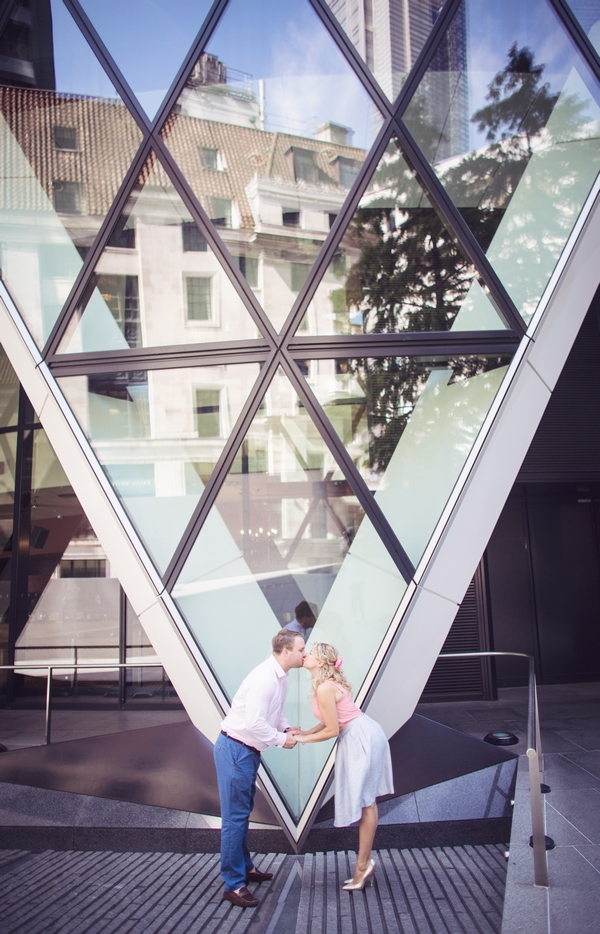 Couple standing in front of The Gherkin