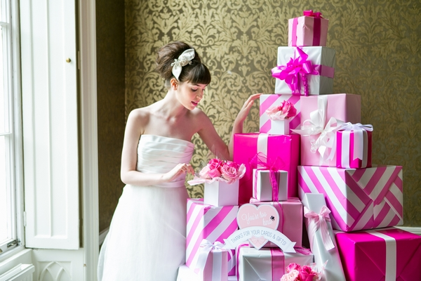 Bride next to pile of pink presents