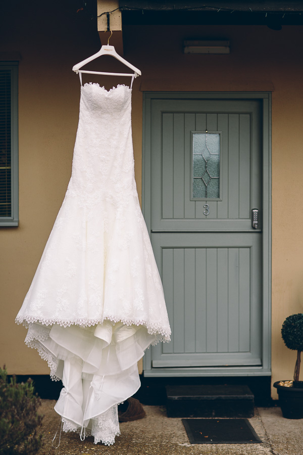 Wedding dress hanging by door