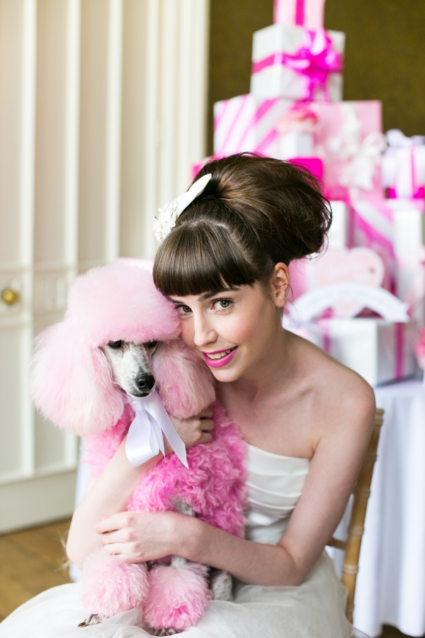 Bride and pink poodle