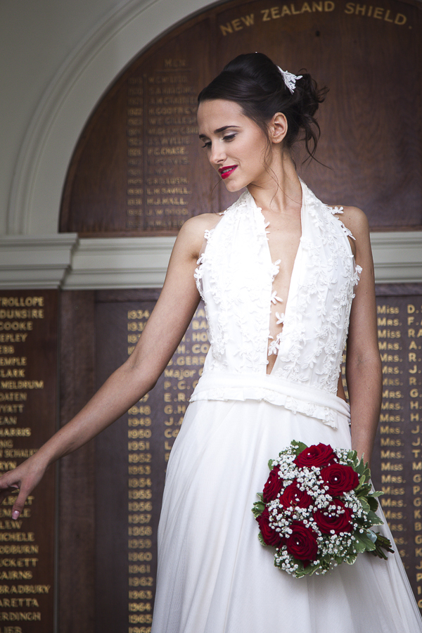 Bride holding winter bouquet