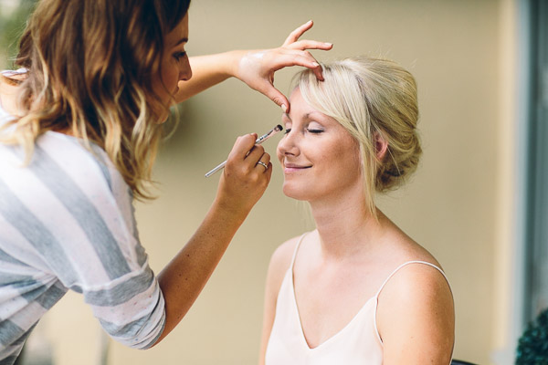 Bride having eye make-up done