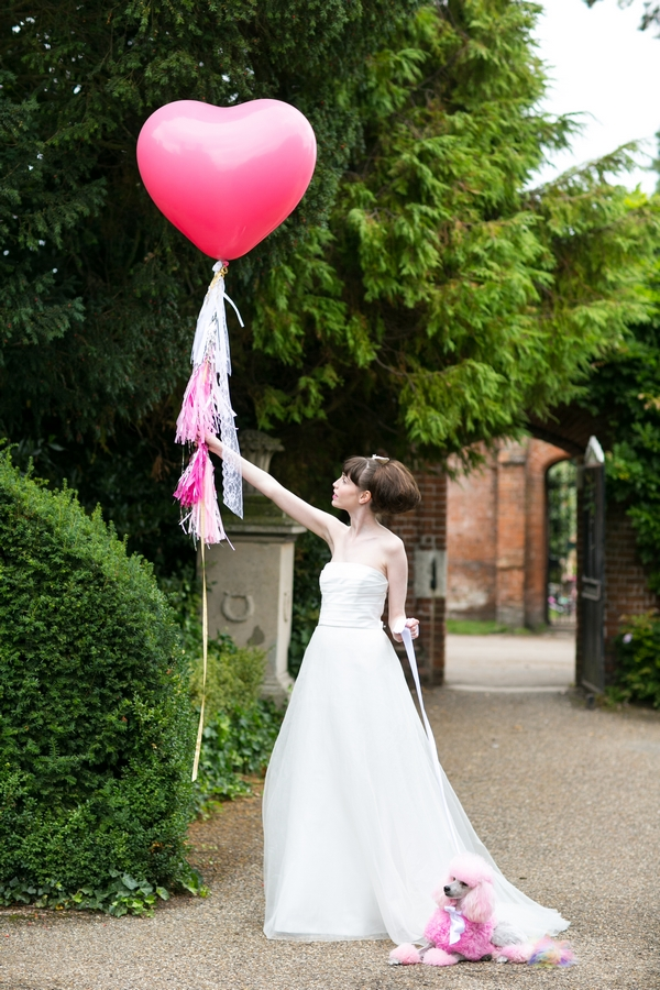 Bride holding pink balloon