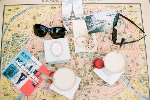 Sunglasses and pictures of Paris on map