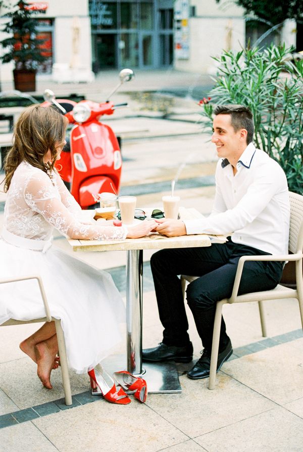Couple sitting at cafe table in Paris