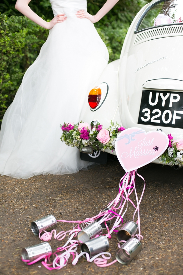 Heart and cans tied to back of VW Beetle