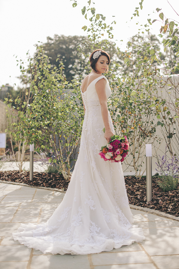 Bohemian bride looking over shoulder