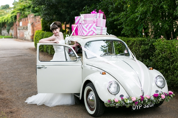 Bride next to VW Beetle
