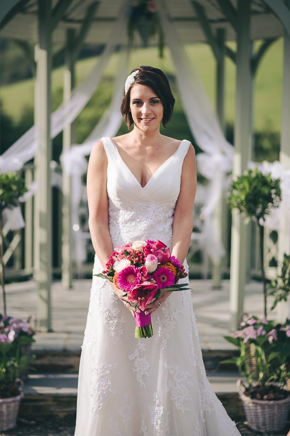 Bohemian bride holding bouquet