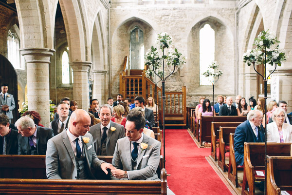 Wedding guests waiting in church