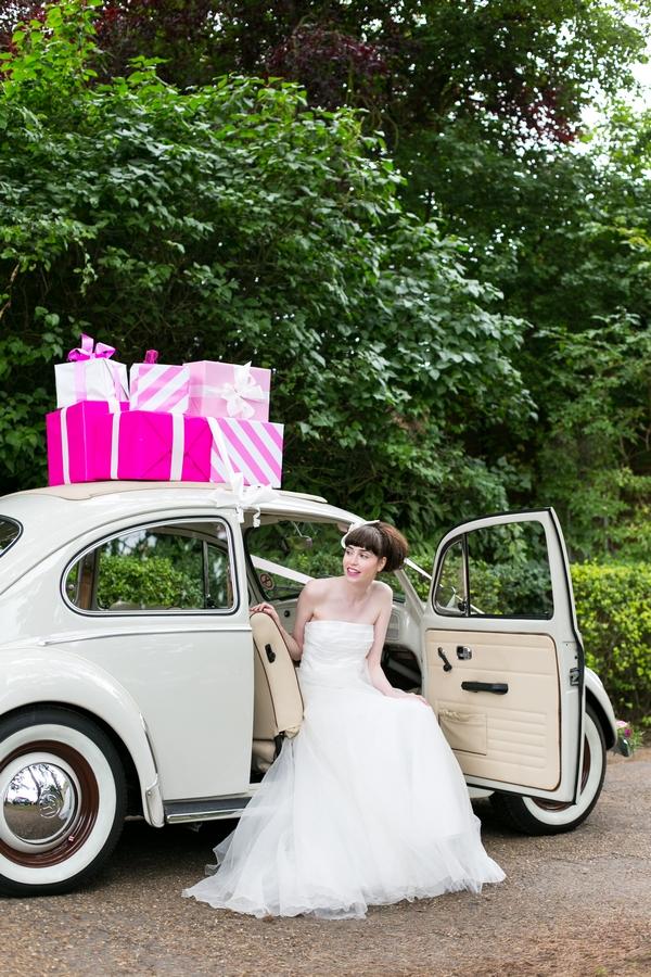Bride sitting in VW Beetle