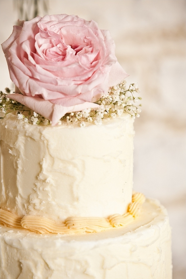 Rose on top of wedding cake