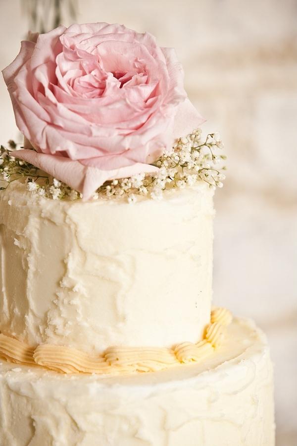 Rose on top of wedding cake