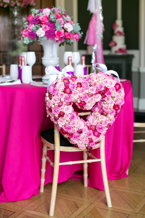 Pink floral heart wreath on back of chair