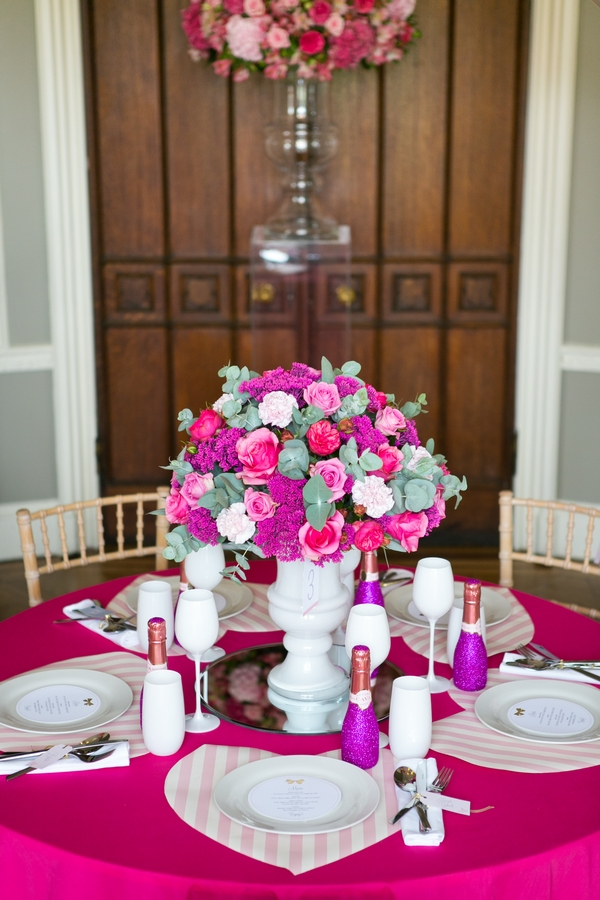 Pink floral wedding table centrepiece